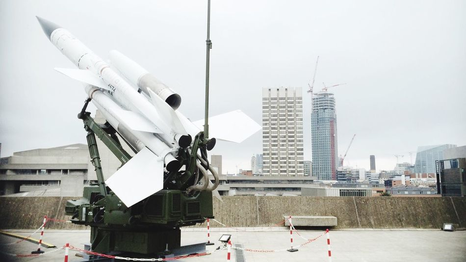 War Barely Hidden Missile Skyline Rooftop Lerone-frames Urban Landscape GreyDay Highrise Looking Into The Future South White Album Rocket Right To Bear Arms Military Art In Context Adventures Beyond The Ultraworld