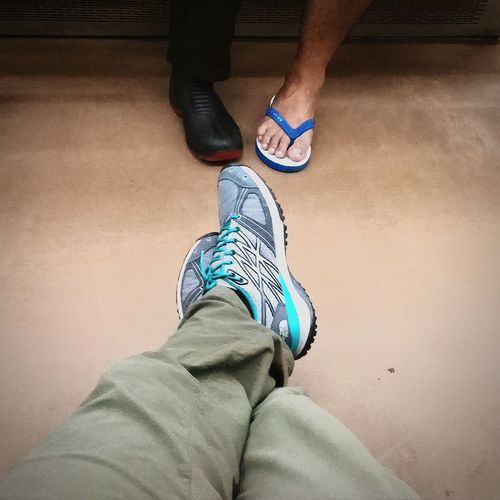 While waiting to the destination... in Commuterline Train Shoes Footwear Sneakers Runningshoes Thenorthface Slippery Boots Rubberboots Publictransportation ART'ventureIndonesia Rannytob Capture Capture The Moment with Xiaomiredminote4 Xiaomiphotography Xiaomiindonesia XiaomiRedmiNote EyeEm Jakarta Jakartastreetphotography Getty Images