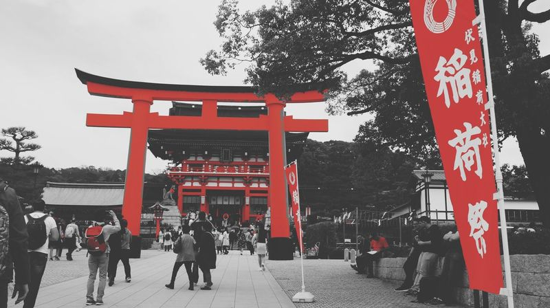 Japan Diaries. An Eye For Travel Red Cultures Travel Tree Travel Destinations Non-western Script Architecture Architectural Column Outdoors City Built Structure Day Real People City Gate Adapted To The City EyeEmNewHere Sky People Miles Away