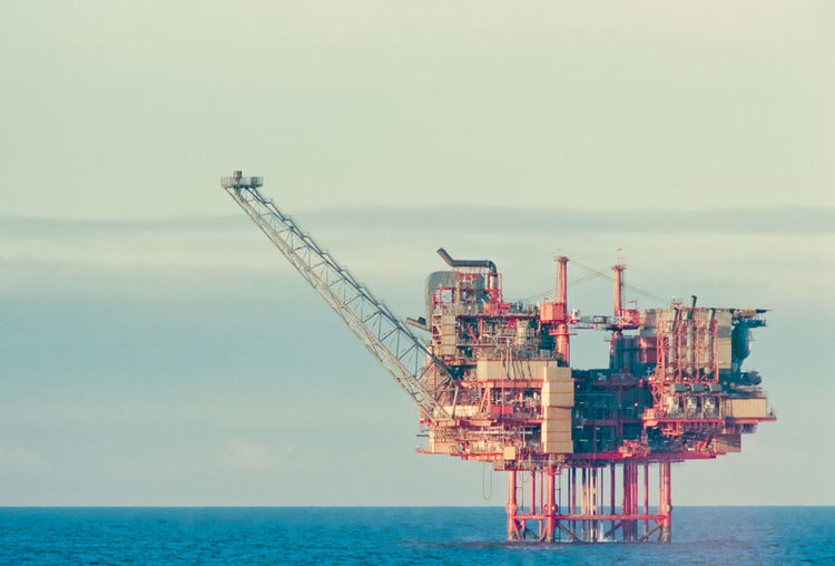 Offshore Oil platform Machinery Red Crude Oil Day Drilling Rig Film Photography Flare Of Light Fossil Fuel Fuel And Power Generation Horizon Horizon Over Water Industry Nature No People Offshore Platform Oil Industry Outdoors Sea Sky Water