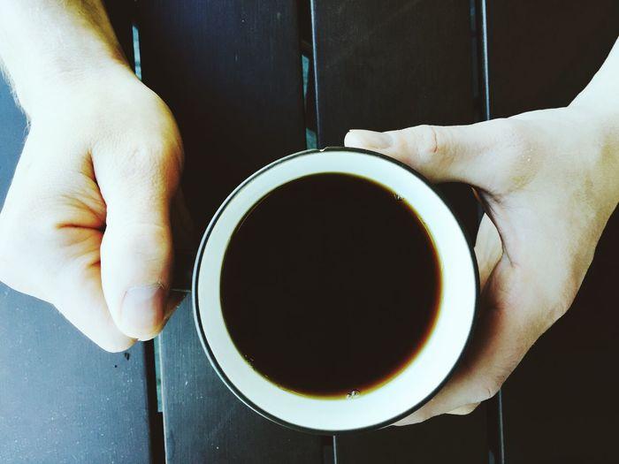Cropped Image Of Man Having Coffee
