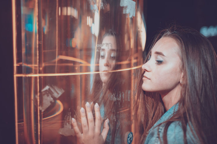 One Person Long Hair Headshot Young Adult Young Women Portrait Brown Hair Hairstyle Hair Window Real People Reflection Looking Women Transparent Glass - Material Adult Indoors  Leisure Activity Beautiful Woman Contemplation Glass The Art Of Street Photography My Best Photo