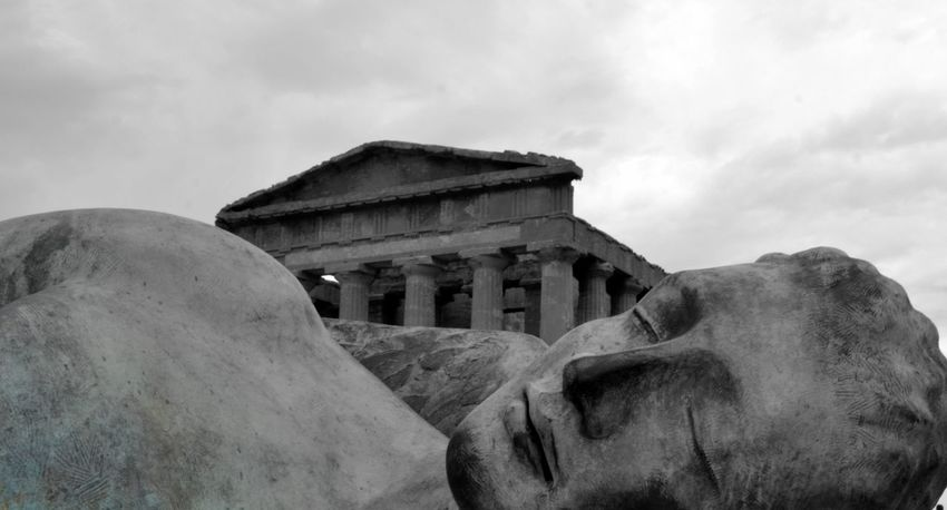 Agrigento Archeologia Architectural Feature Architecture Bronzo Building Exterior Built Structure Cloud - Sky Cloudy Day Famous Place High Section History Low Angle View No People Outdoors Rural Scene Sculture Sicily Sky Stone Material Tempio The Past Valle Dei Templi Weathered