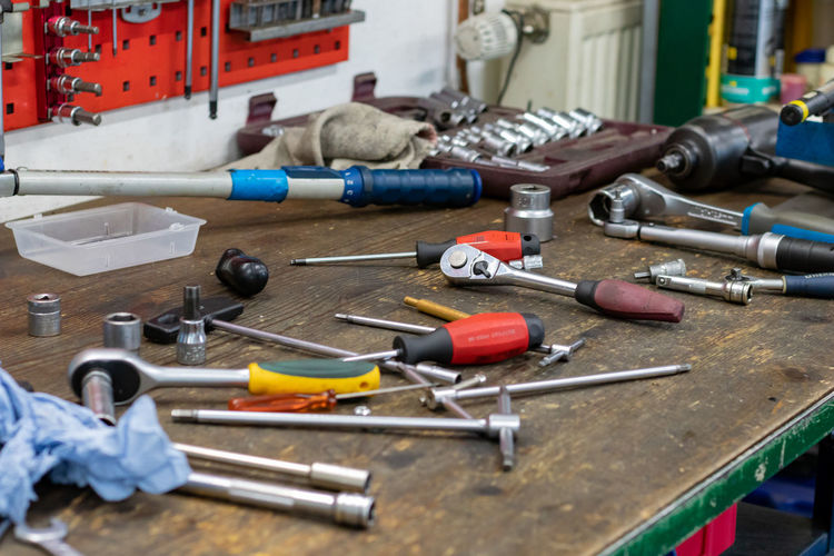 Close-up of work tools on workbench at workshop