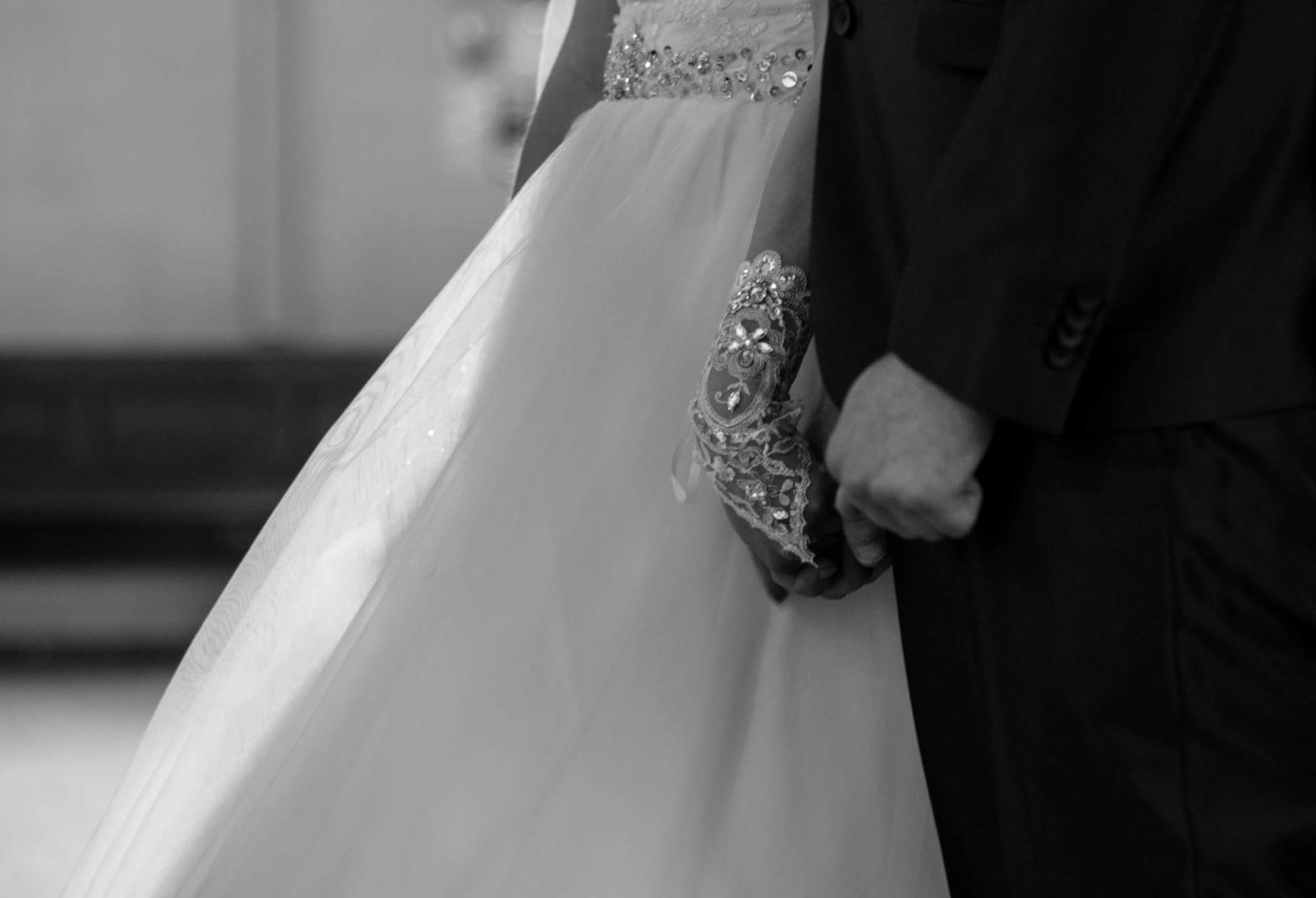 person, sitting, bride, wedding, midsection, jewelry, togetherness, couple - relationship, lifestyles, femininity, veil, holding, well-dressed