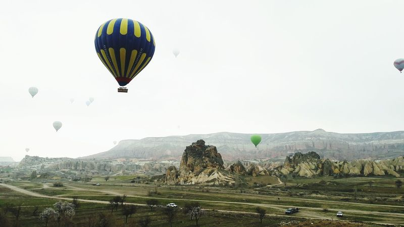 EyeEmNewHere Balloon ride in Cappadocia, Turkey. Hot Air Balloon Flying Air Vehicle Mountain Outdoors Adventure Day Nature Fog Sky Beauty In Nature