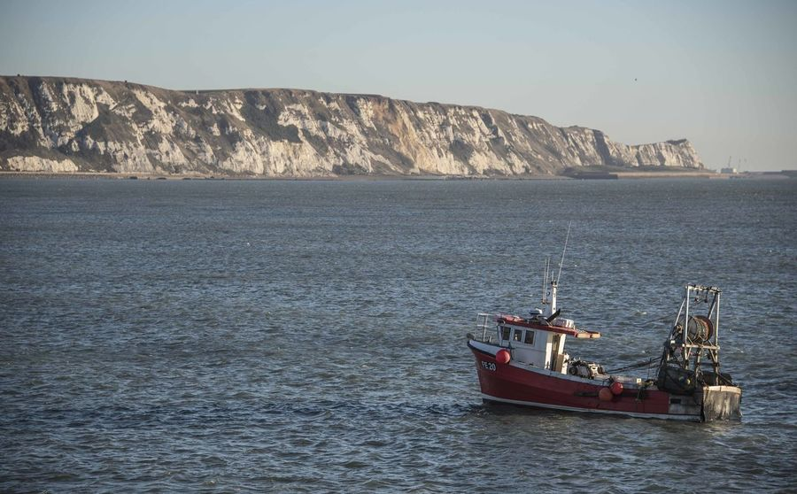 A fishing vessel outside Folkestone, Kent Beauty In Nature Clear Sky Day Moored Nature Nautical Vessel No People Outdoors Scenics Sea Sky Transportation Water