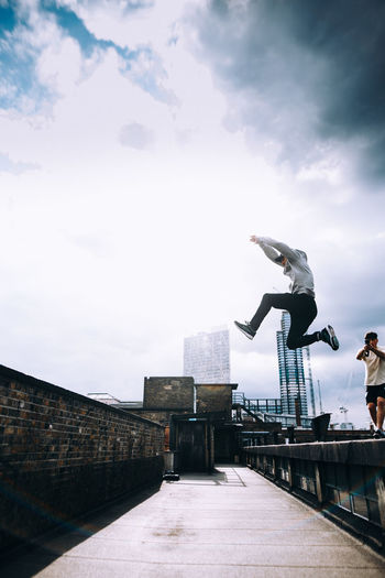 Check This Out City City Life Exploring EyeEm EyeEm Best Shots London Parkour The Great Outdoors - 2018 EyeEm Awards Architecture Built_Structure Cloud - Sky Day Full Length Jumping Leisure Activity Lifestyles Mid-air Motion One Person Outdoors Real People Sky Skyscraper Streetphotography Summer Sports The Week On EyeEm Editor's Picks