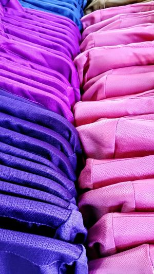 Full frame shot of colorful bags for sale in store