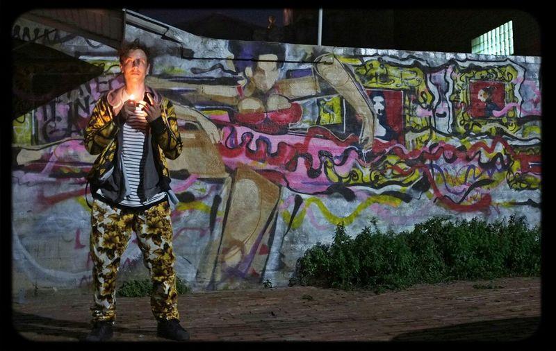 Anthony Lister posing beside his Ballerina in Melbourne Streetart