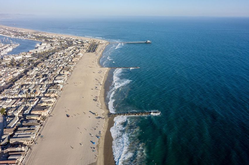 aerial drone view of Balboa Peninsula in Newport Beach California showing the beach, homes and the ocean Beach Front Property Newport Beach, CA, USA Aerial View Architecture Balboa Peninsula Beach Beach Front Living Blue Blue Water Coastal Living Drone View Urban Expensive Home High Angle View Land Nature Outdoors Pacific Ocean Peninsula Sea Sky Water Wealthy Lifestyle