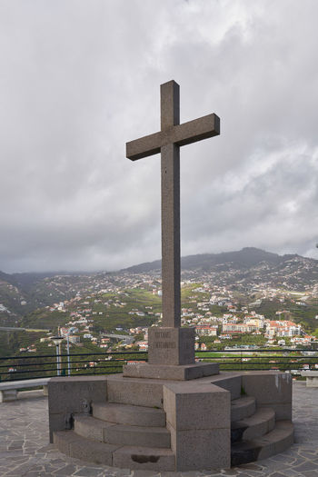 Miradouro da Torre viewpoint cross on Câmara de Lobos, Madeira Autumn Christian Christianity Cloudy Cross Jesus Christ Madeira Portugal Portuguese Sign Top Travel Architecture Belief Building Cross Island Landscape Mountain Nature Outdoors Religion Religious  Spirituality Viewpoint