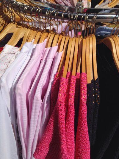 Dresses Hanging On Hanger In Shop