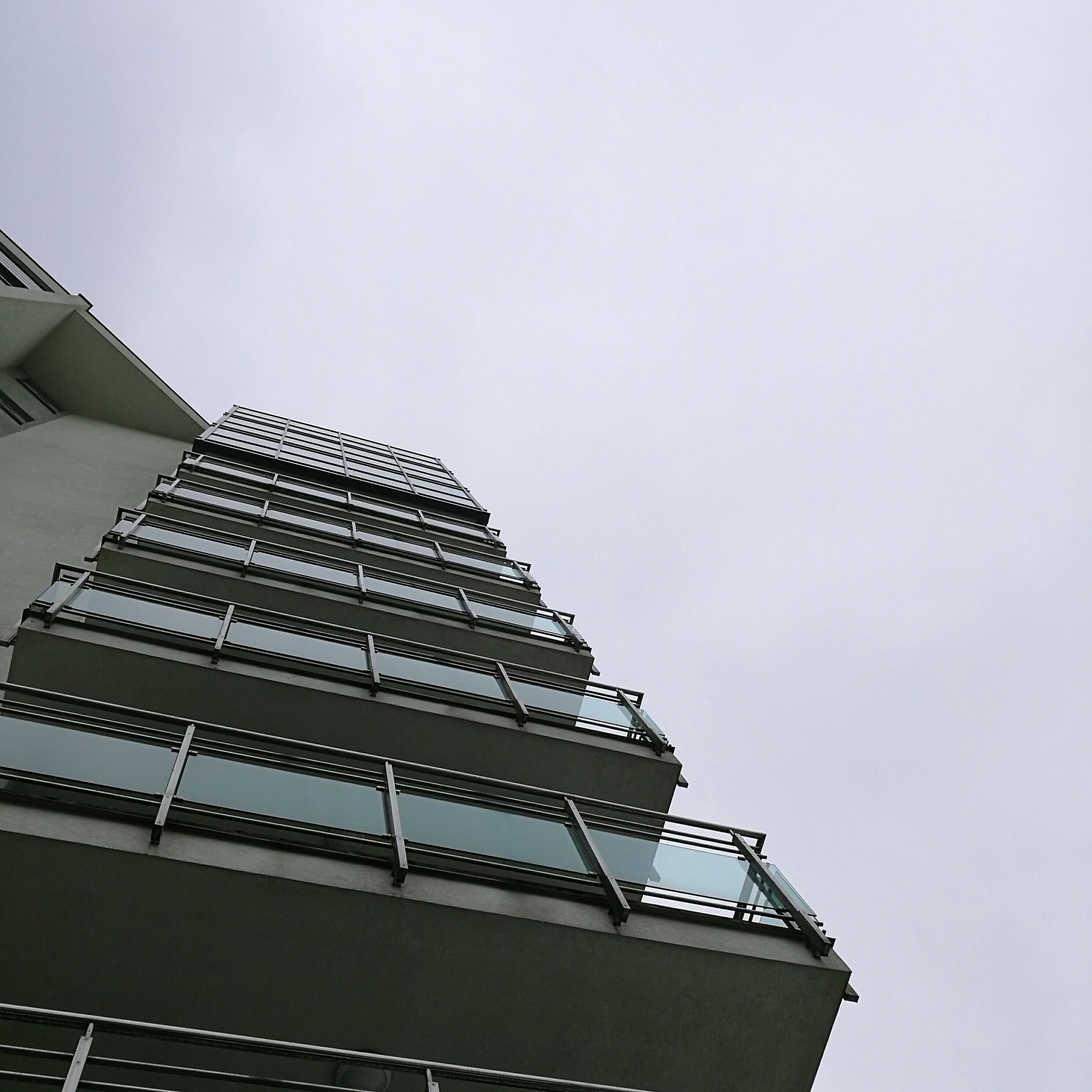 built structure, clear sky, architecture, low angle view, building exterior, no people, sky, outdoors, day, renewable energy