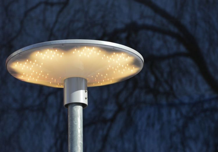 Low angle view of illuminated street light