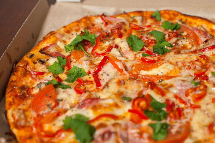 Opened box with pizza on the table Baked Basil Cheese Close-up Cooked Fast Food Flatbread  Food Food And Drink Freshness Indoors  Italian Food No People Pizza Ready-to-eat Serving Size SLICE Table Unhealthy Eating