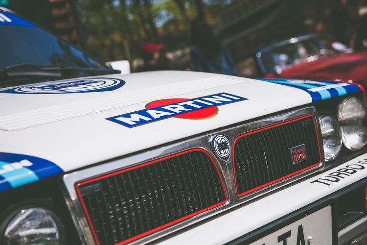 Nice day for a Martini Martini Car Close-up Communication Day Flag Focus On Foreground Independence Lancia Delta Land Vehicle Mode Of Transportation Motor Vehicle No People Outdoors Patriotism Police Car Red Retro Styled Stationary Text Transportation Western Script