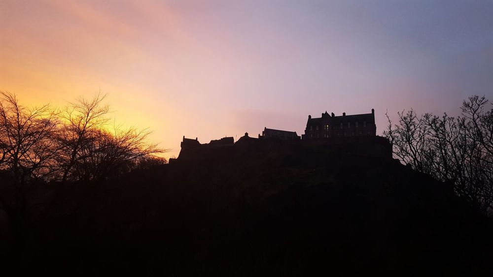 Sunrise in Edinburgh Outdoor Photography Scotland Shades Of Winter No Filter, No Edit, Just Photography No Filters Or Effects Sunrise Morning Light Gratitude Sky Colours Scotland Scottish Castle Medieval Scotland 💕 Edinburgh Castle Sunset Outdoors Old Ruin Silhouette