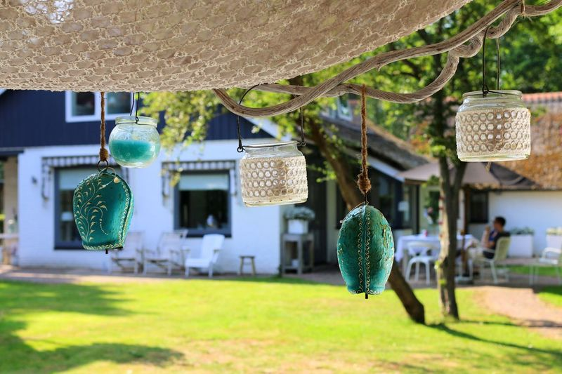 Decorative Lights Hanging On Porch Roof