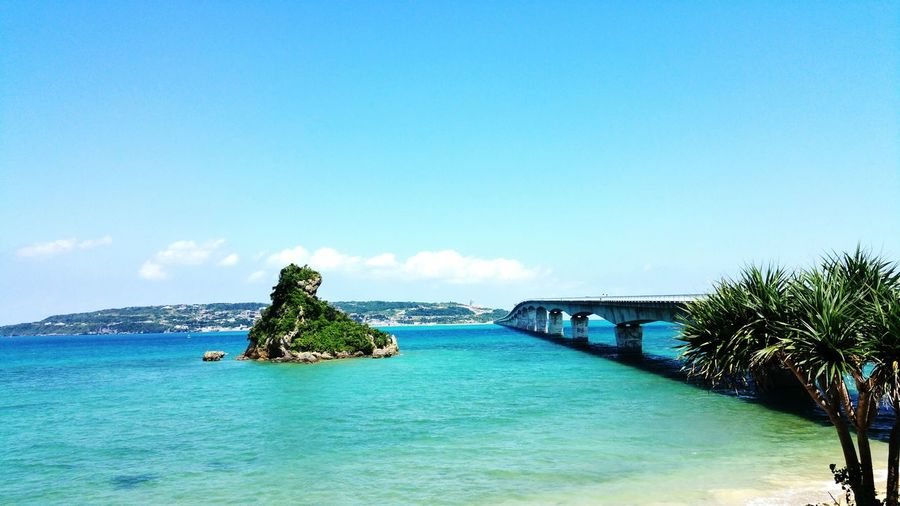 Scenic view of bridge between islands