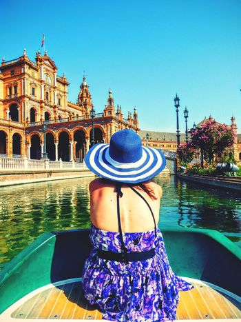 Architecture Water Building Exterior Built Structure Blue Clear Sky Travel Destinations Famous Place Tourism Culture Multi Colored Woman In Dress Boat Woman In Hat Women Who Inspire You Women Of EyeEm People And Places Woman Andalucía