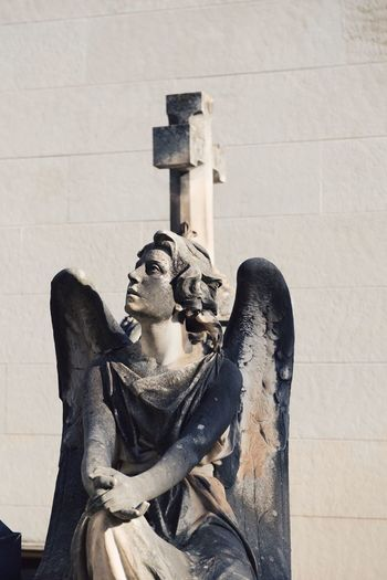 Winged statue against the wall