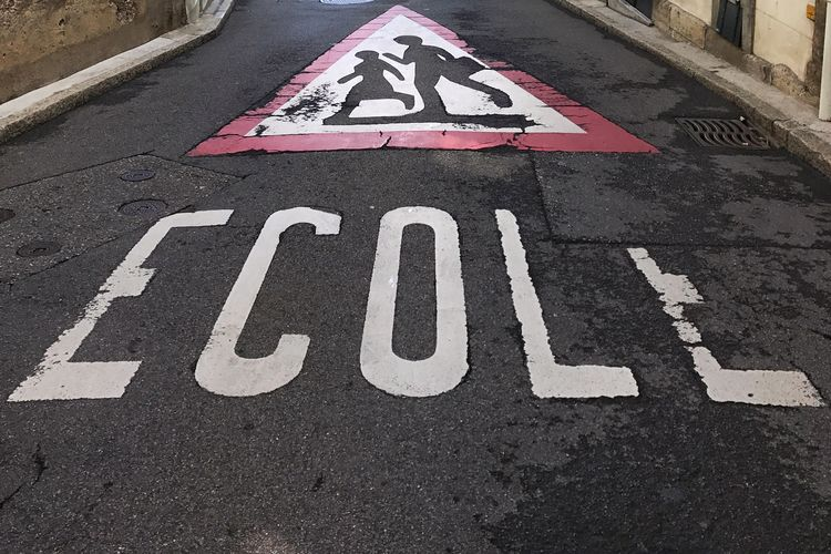 High angle view of road sign in city