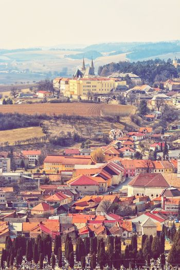 Slovakia City Cityscape Community Town Sea Residential Building Aerial View Water High Angle View Roof Housing Settlement TOWNSCAPE Townhouse Row House Bell Tower Housing Development Tiled Roof  Old Town Residential Structure Rooftop Residential District Human Settlement