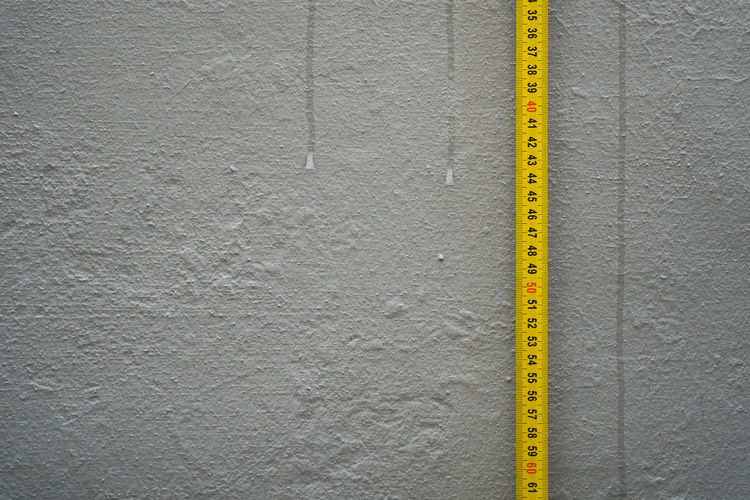 Measure Tape Against Gray Wall