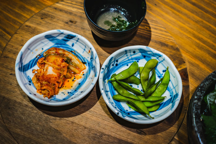 Korean dish Food And Drink Food Table Freshness Bowl Ready-to-eat High Angle View Wellbeing Indoors  No People Still Life Healthy Eating Close-up Wood - Material Asian Food Serving Size Plate Vegetable Japanese Food Meal Temptation Snack Dinner Korean Dish
