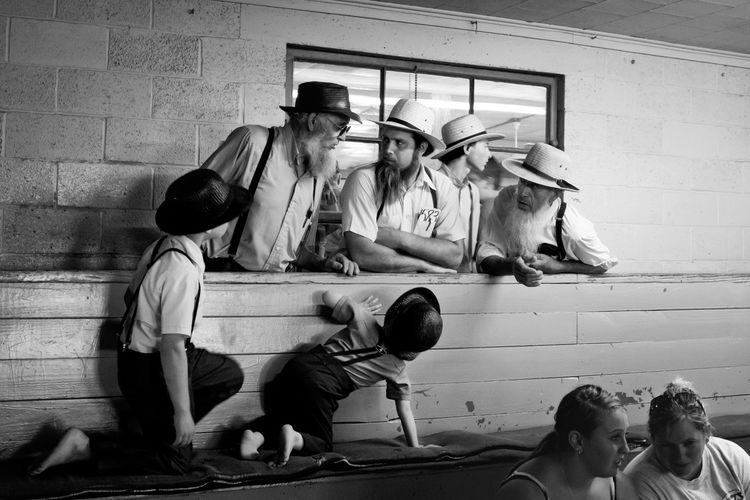 I took this picture of a group of amish men during a livestock auction in a small town in Iowa, USA. Amish Country Hats Men People People Photography People Portrait The Portraitist - 2017 EyeEm Awards Togetherness Young Adult