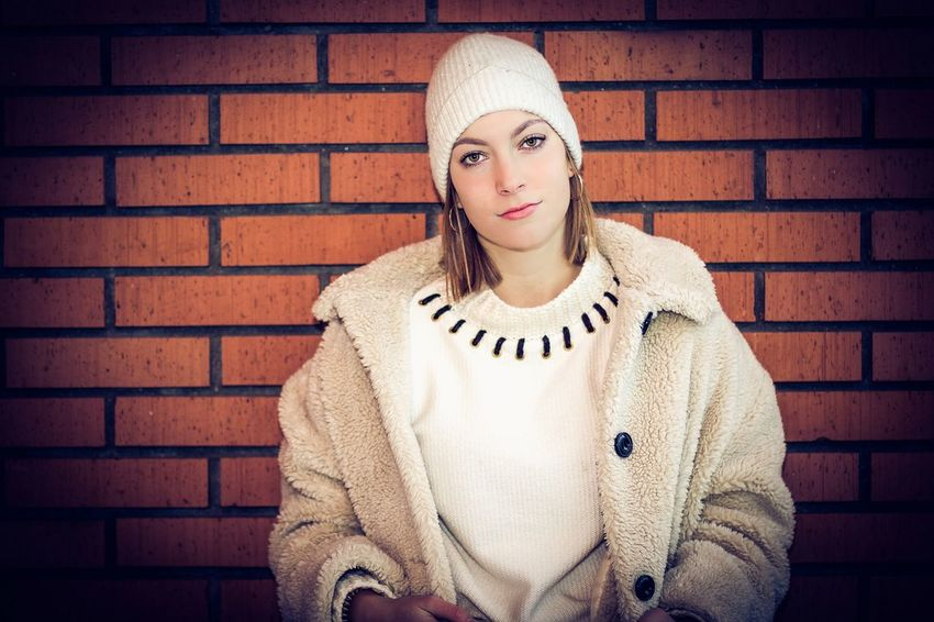 beauty Portrait Looking At Camera Brick Wall Brick Wall Young Adult One Person Winter Front View Clothing Adult Warm Clothing Sweater Women Young Women Beauty Headshot Wall - Building Feature Beautiful Woman Scarf Hairstyle