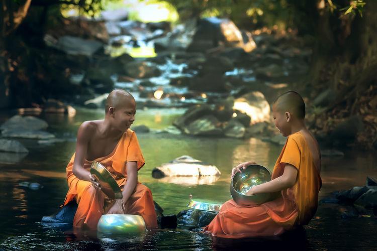 Monks Sitting In Lake