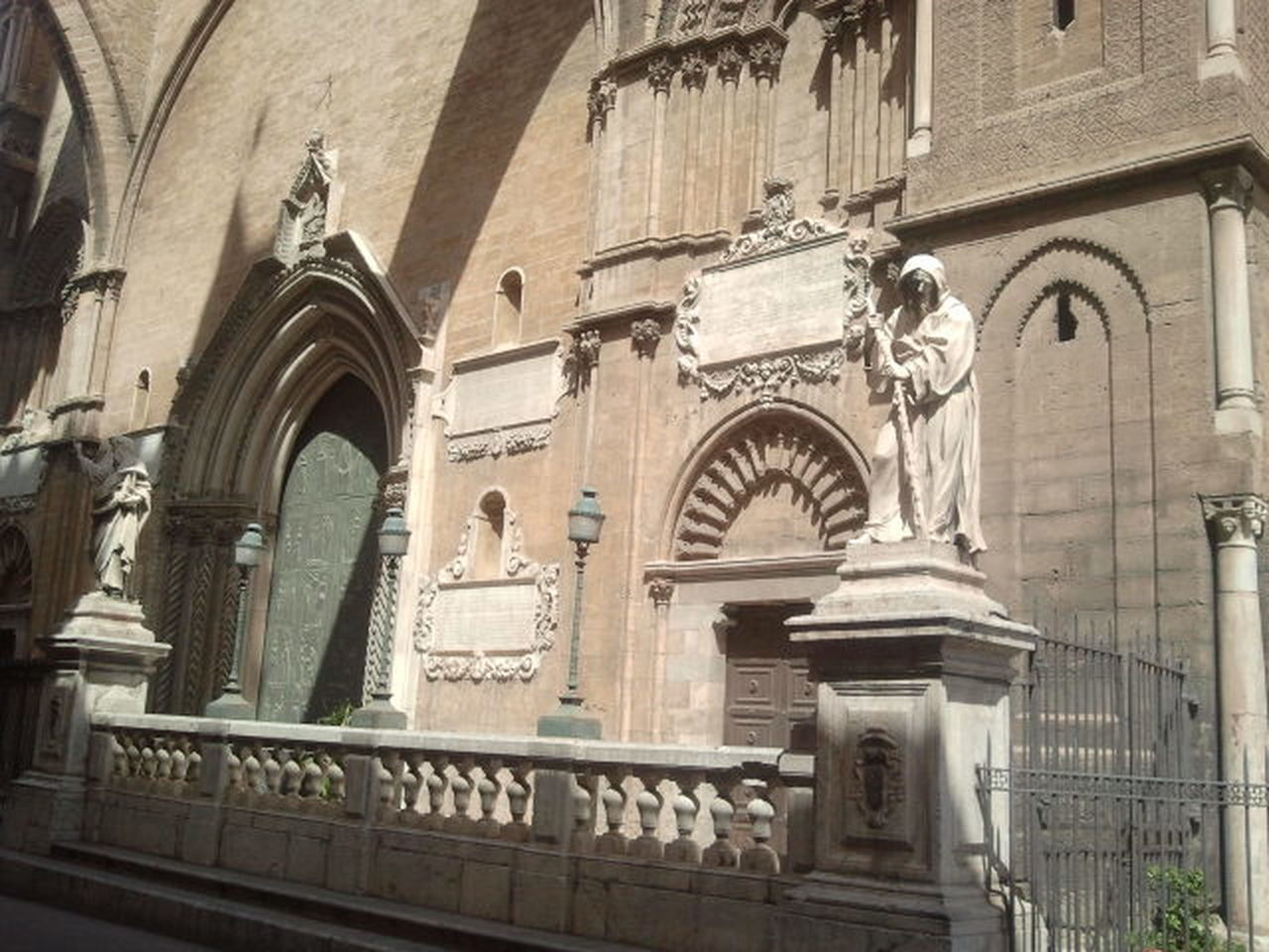 architecture, arch, built structure, building exterior, day, history, low angle view, no people, statue, sculpture, outdoors
