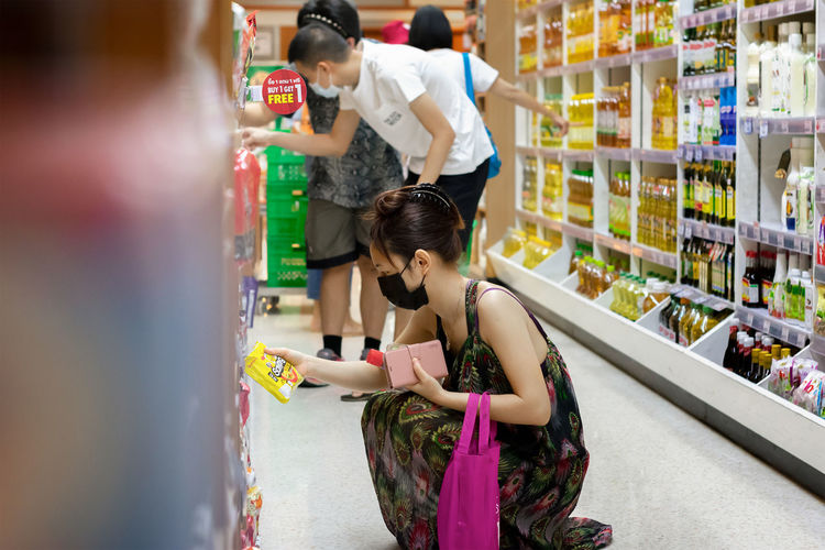 Side view of women standing in store