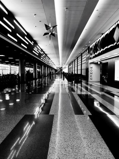 Transportation Built Structure Mode Of Transportation Public Transportation Incidental People Ceiling Direction Diminishing Perspective Architectural Column Indoors  Travel Illuminated Reflection The Way Forward