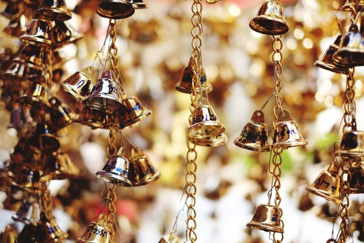 Close-up of decorations hanging for sale in market