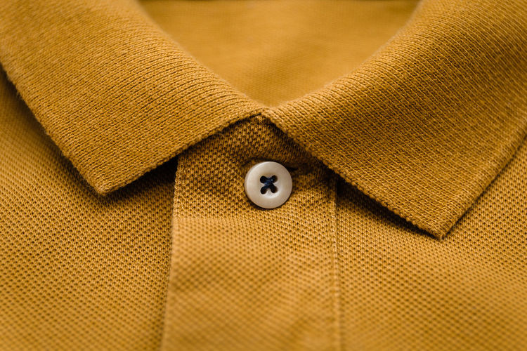 Close up of male polo shirt with buttoned collar neck Textile Texture Clothing Button Close-up Fashion No People Apparel Defocused Casual Clothing Casual Look Cloth Collar Collection Color Copy Space Cotton Design Detail Fabric Fashionable Garment Gray Yellow Green Male Man Modern Outfit Pattern Polo Shirt  Shirt Shop Store Sweater Sweatshirt T-shirt Still Life Wear Front View