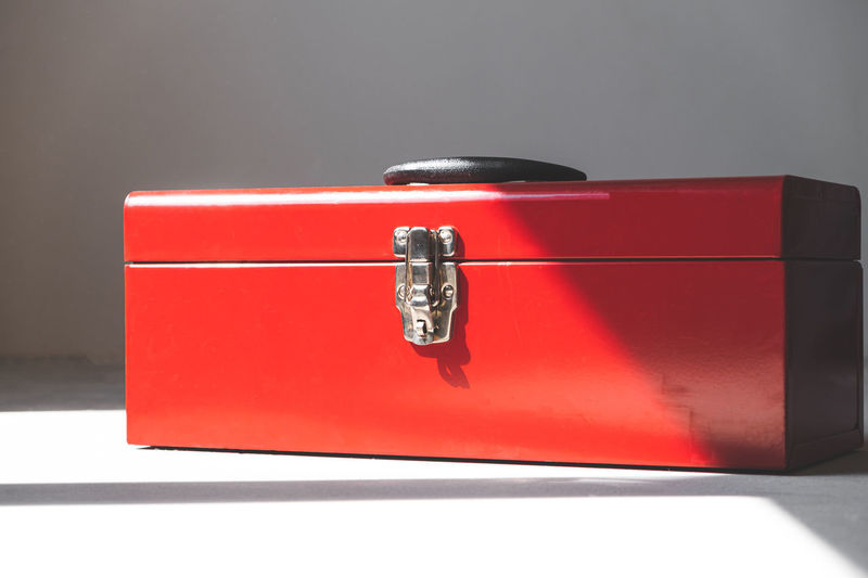 Close-up of red box against wall