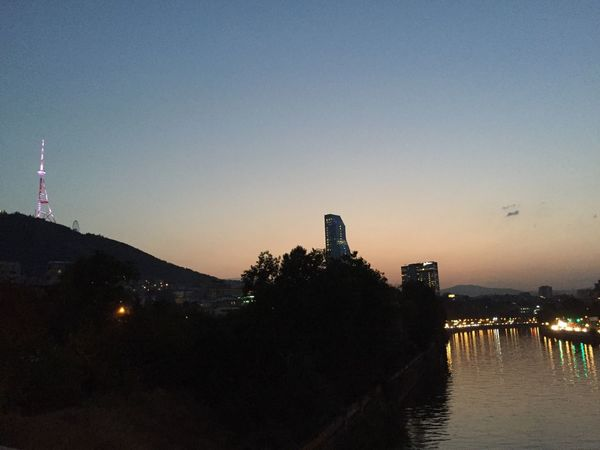 Architecture Built Structure Building Exterior Sunset Water Outdoors Silhouette Travel Destinations Clear Sky Sky No People City Nature Day Night Tbilisi Sky Orange Color New Architecture Walking Georgia Tbilisi Bridge River River Mtkvari Trees Discover Berlin Lost In The Landscape Lost In The Landscape