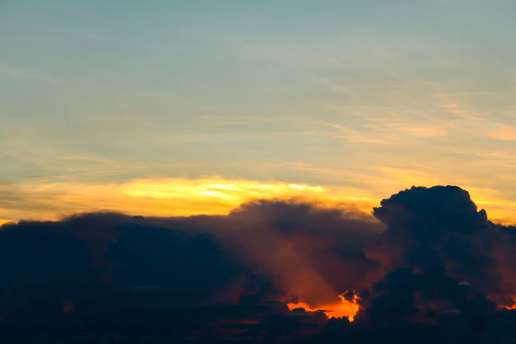 Silhouette smoke emitting against sky during sunset