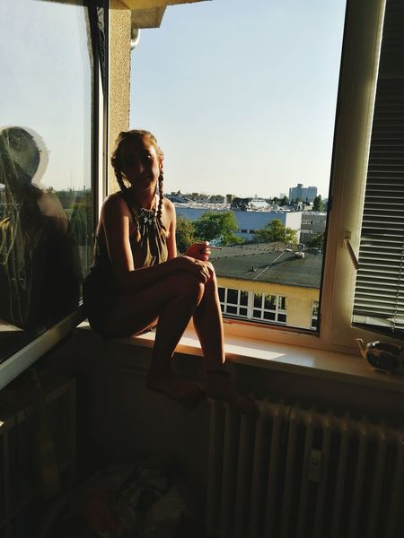 My Favorite Place Homepage Window Berlin Architecture Built Structure Indoors  Leisure Activity Lifestyles Casual Clothing Window Building Exterior Balcony City Young Women Sitting Home Interior Young Adult Full Length Person Sky Day Railing City Life Battle Of The Cities