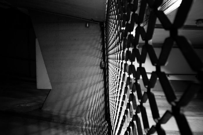 Architecture Artistic Black And White Building Exterior Built Structure Close-up Closed Closed Grid Grid Moody Night Nightphotography No People Parking Garage Shadow Strength The Street Photographer - 2017 EyeEm Awards Tranquil Scene Underground Parking