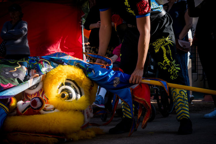 Eye of the Dragon: Chinese dragon costume on ground after a performance of the Chinese dragon dance at 2018 Chinese New Year festival at Balboa Park in San Diego, California Border Collie Diversity Dragonfly Immigration Tradition USA Photos Chinese Culture Chinese Drago Dance Chinese Dragon Chinese Dragon Costume Chinese Dragon Eye Chinese New Year 2017 Chinese New Year Festival Cultures Dragon Eye Ethnic Low Section Men Multi Colored Multiculturalism Night Outdoors People Real People Yellow Eyes