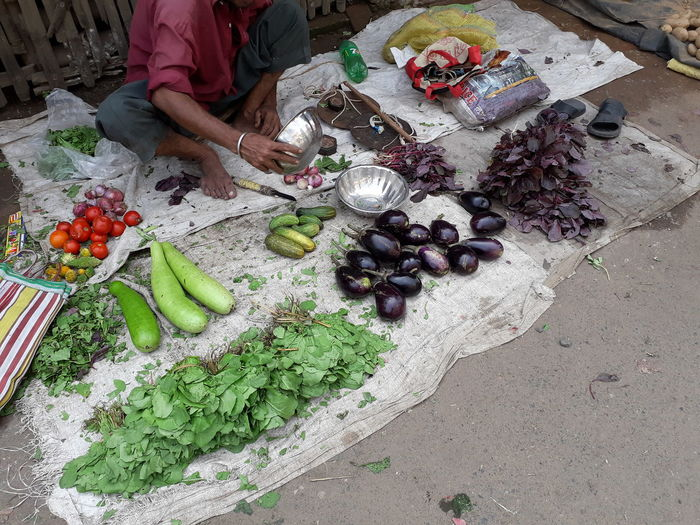 High angle view of man preparing food at market stall