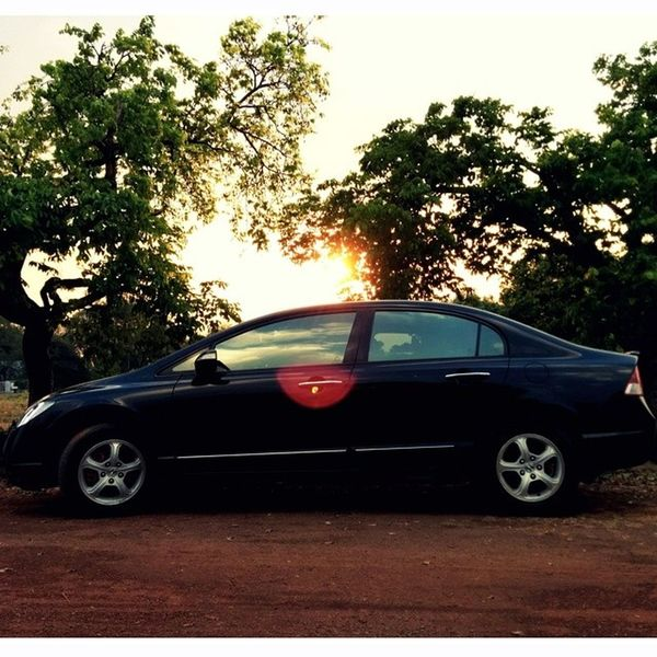 Bhilai City Town Evening sunset eve hangout friends black beast blacklist blacklistlifestyle sports honda civic trees greenery tint sunrays instaedit instagood