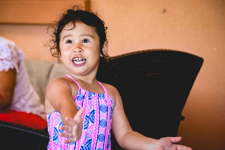 candid portrait of a very excited little girl Diversity Childhood Child Real People One Person Cute Innocence Girls Front View Portrait Lifestyles Looking Away Looking Smiling Emotion Mouth Open Excitement Candid Toddler