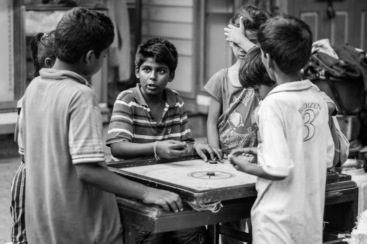 The BOARD meeting!!! Kids Streetphotography Carromboard Blackandwhite Street Photography Showcase March