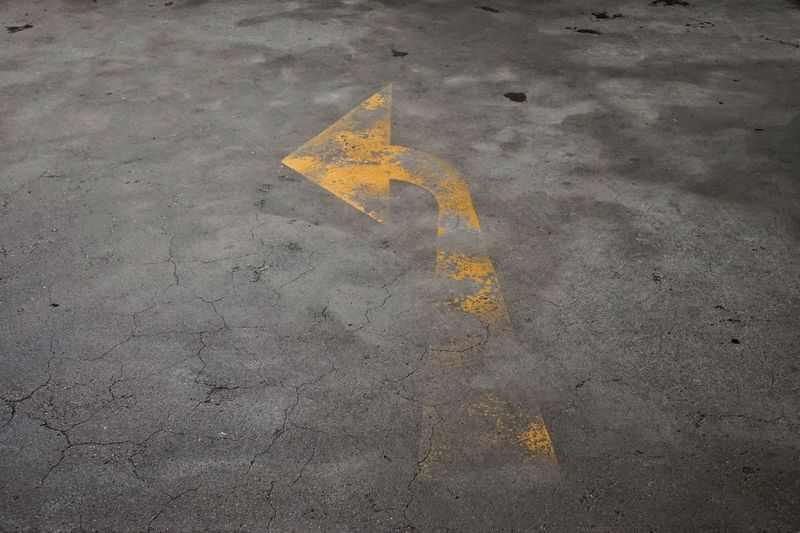 High angle view of arrow sign on road