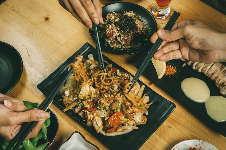 Chopsticks Close-up Day Food Food And Drink Freshness Healthy Eating Holding Human Body Part Human Finger Human Hand Indoors  Leisure Activity Lifestyles Men One Person People Ready-to-eat Real People Seafood Table